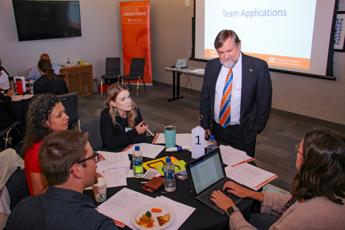 candid photo of a group sitting at a table at the team-based learning workshop